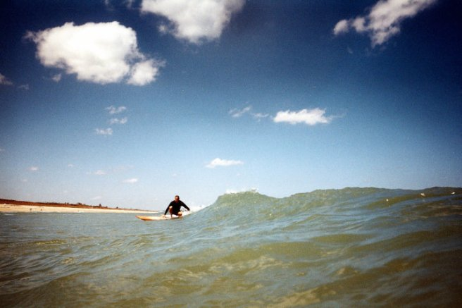 Surfer at Refuge Beach